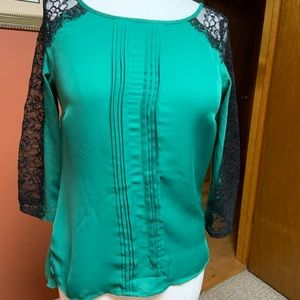 Lauren Conrad green shirt and black lace sleeves